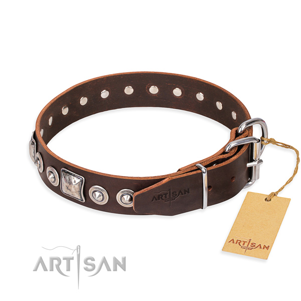 Leather dog collar made of soft to touch material with reliable decorations